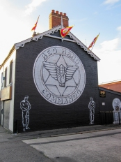 Flag on Red Hand Commando mural, Newtownards Road, Belfast, Northern Ireland. (c) Gordon GILLESPIE